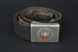 Ceinturon de la Heer Ceinturon en cuir noir, taille 92, marquage illisible, trace d'un éclat de