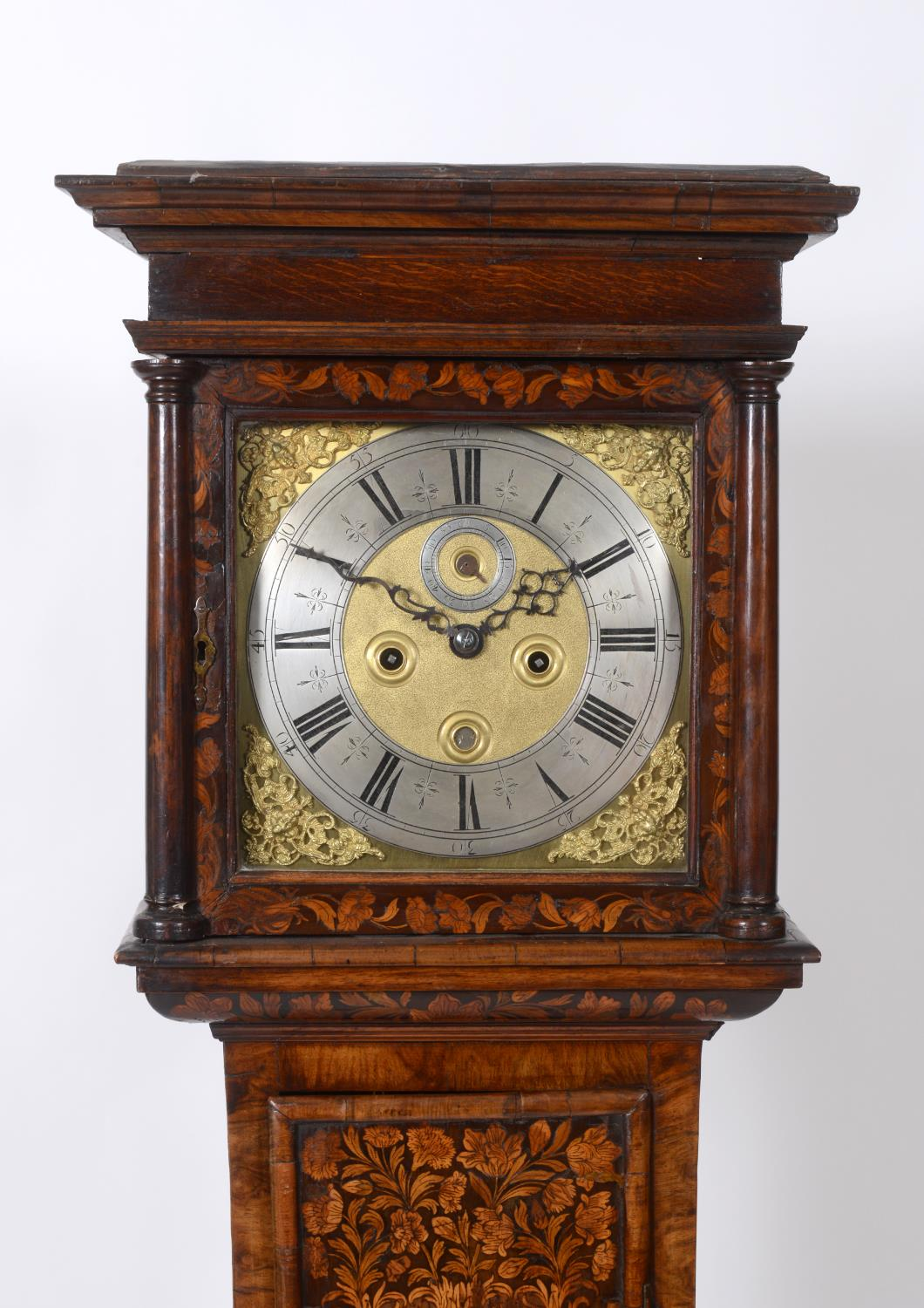 A longcase clock, the 27 cm square brass dial with a silvered chapter ring having Roman numerals,
