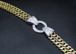 Armband in 750er Gelb/Weißgold gearbeitet mit 52 Brillanten, gesamt ca. 0,57 ct, mittlere