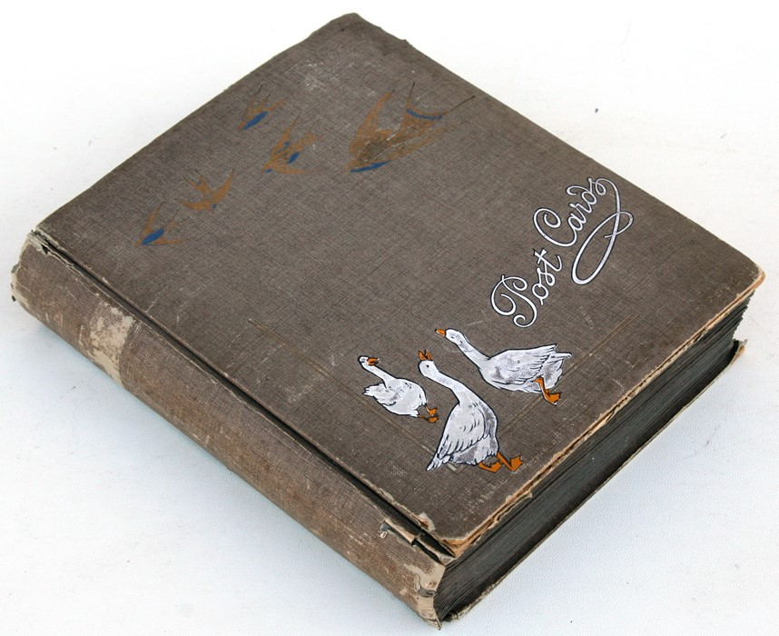Lot 27 - An album containing early 20th century postcards.