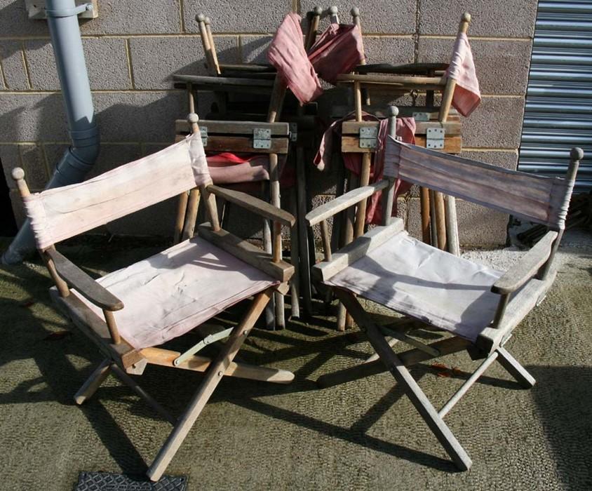Lot 3 - A set of eight folding teak & canvas garden directors chairs.Condition ReportCanvas somewhat