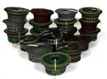 Lot 40 - A group of nineteen traditional hand woven South African Zulu Isicholo hats (19)..