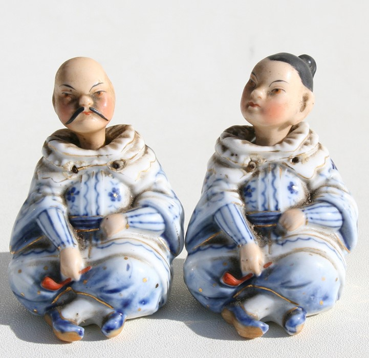 Lot 23 - A pair of Victorian porcelain nodding figures in the form of a seated Chinese couple, 7cms (2.75ins)