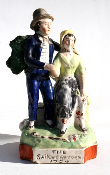 Lot 15 - An 18th century Staffordshire group 'The Sailor's Return', 23cms (9ins) high.
