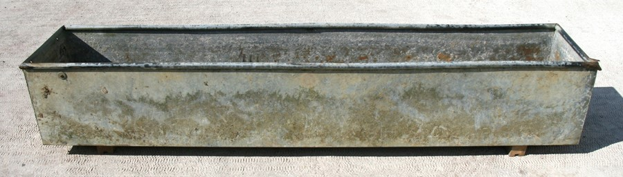 Lot 7 - A large galvanised rectangular trough or planter, 246cms (97ins) long