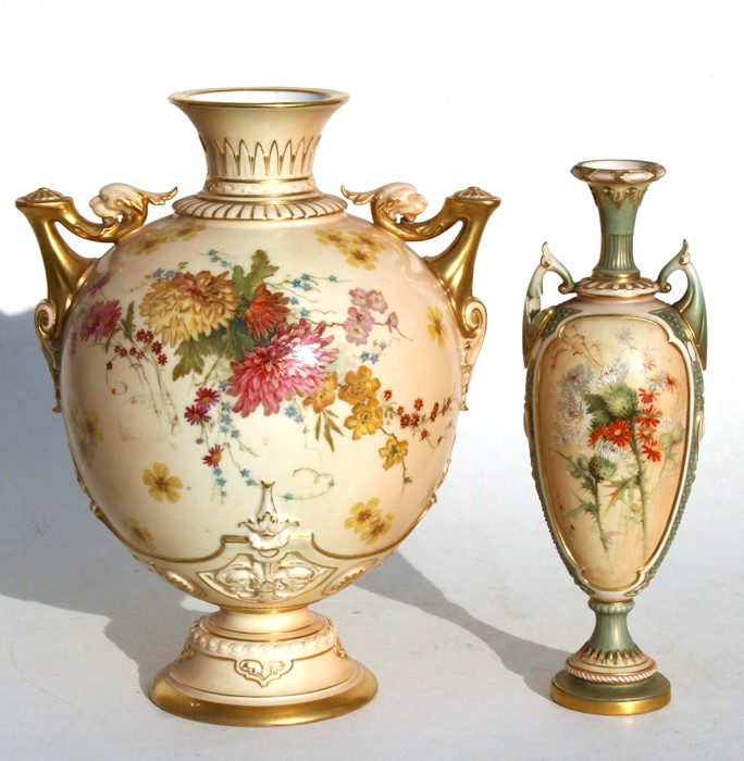 Lot 16 - A Victorian Royal Worcester two-handled vase of globular form decorated with flowers on a blush