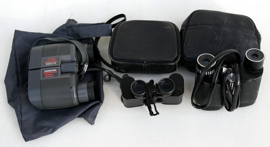 Lot 56 - Three sets of compact binoculars including Nikon.