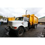 CAMION A REBUS INTERNATIONAL 40S, 10 ROUES, CHARGEMENT LATERAL, BRAS GINGRAS, MOTEUR TD466, BENNE