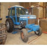 """FORD 7700 DIESEL TRACTOR WITH 4.2L 4 CYLINDER ENGINE, 60"""" REAR TIRES, ENCLOSED CAB, RADIO, CLIMATE"""