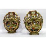 Pair of Japanese Satsuma earthenware disc vases,