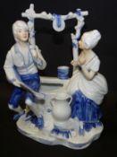 Paar an Brunnen, bemalt, H-18 cm, B-15 cm,