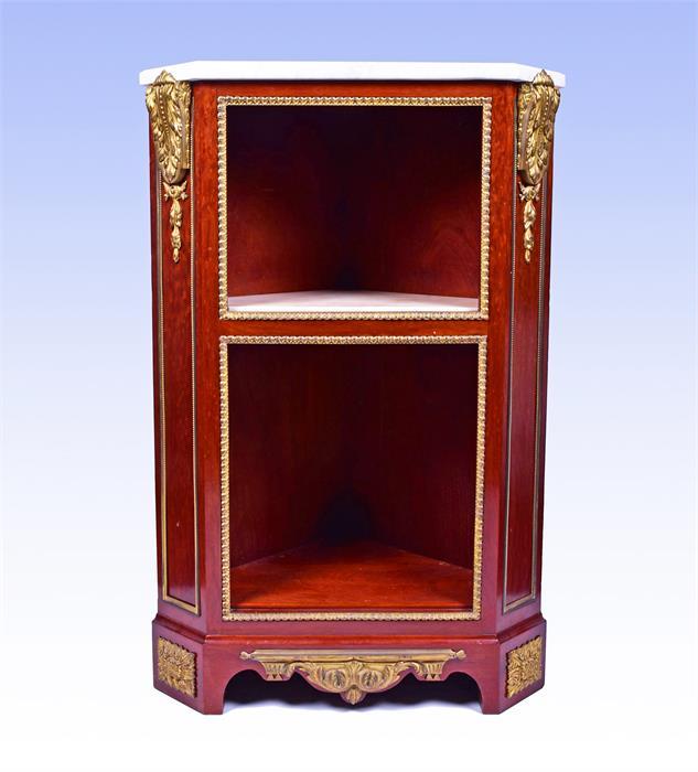 A late 18th century Louis XVI style ormolu mounted mahogany corner cabinet by Jean Henri Riesener (