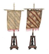 A pair of Egyptian Revival pole screens