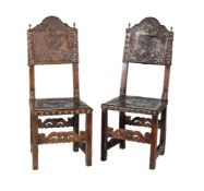 A pair of Spanish walnut and embossed leather side chairs