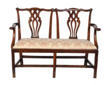 A George III mahogany double chair back settee