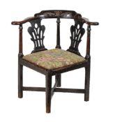 A George III mahogany corner armchair