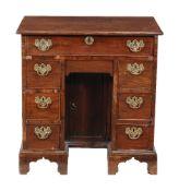 A George II mahogany kneehole desk