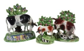 A Staffordshire pearlware bocage model of a black and white horned cow