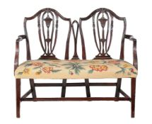 A mahogany double chair back settee in George III style