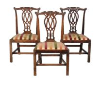 A set of three George III mahogany side chairs