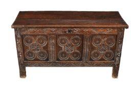 A carved oak triple panel coffer