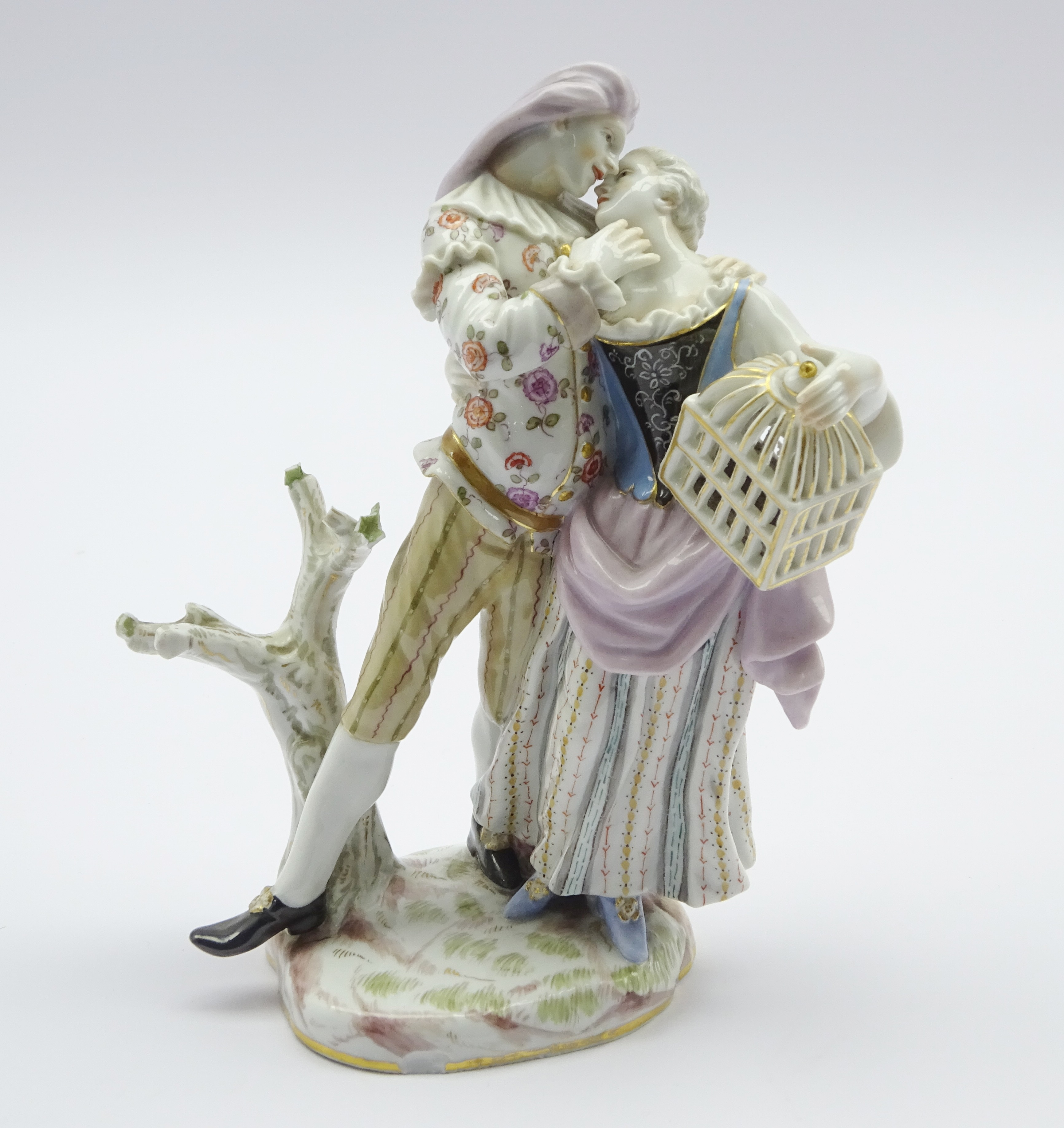 Lot 24 - 19th century Meissen figure of a couple embracing, the woman carrying a bird cage, incised 169, H17.