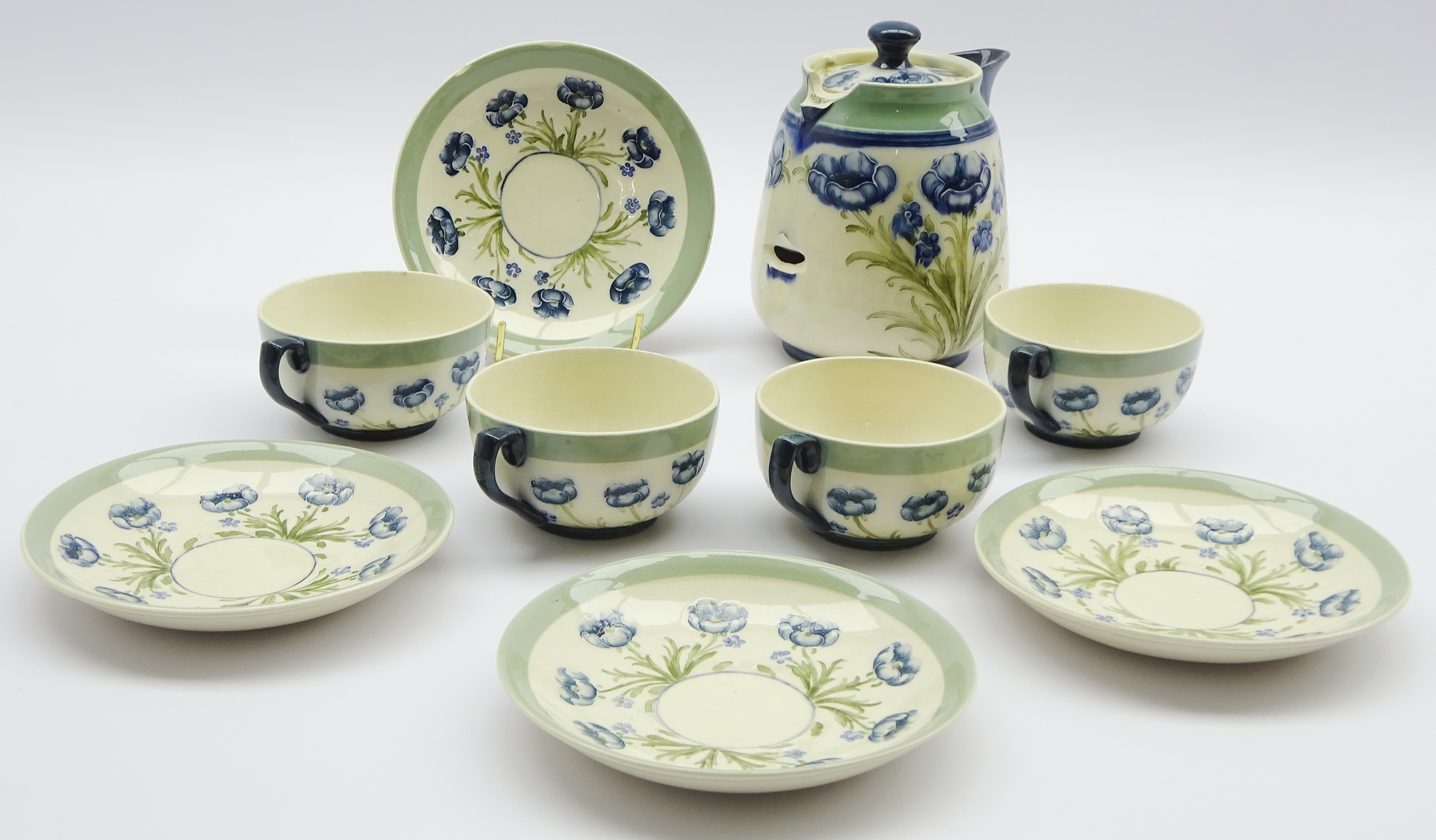 Lot 4 - Moorcroft Macintyre part tea set decorated with the blue poppy pattern comprising four tea cups and