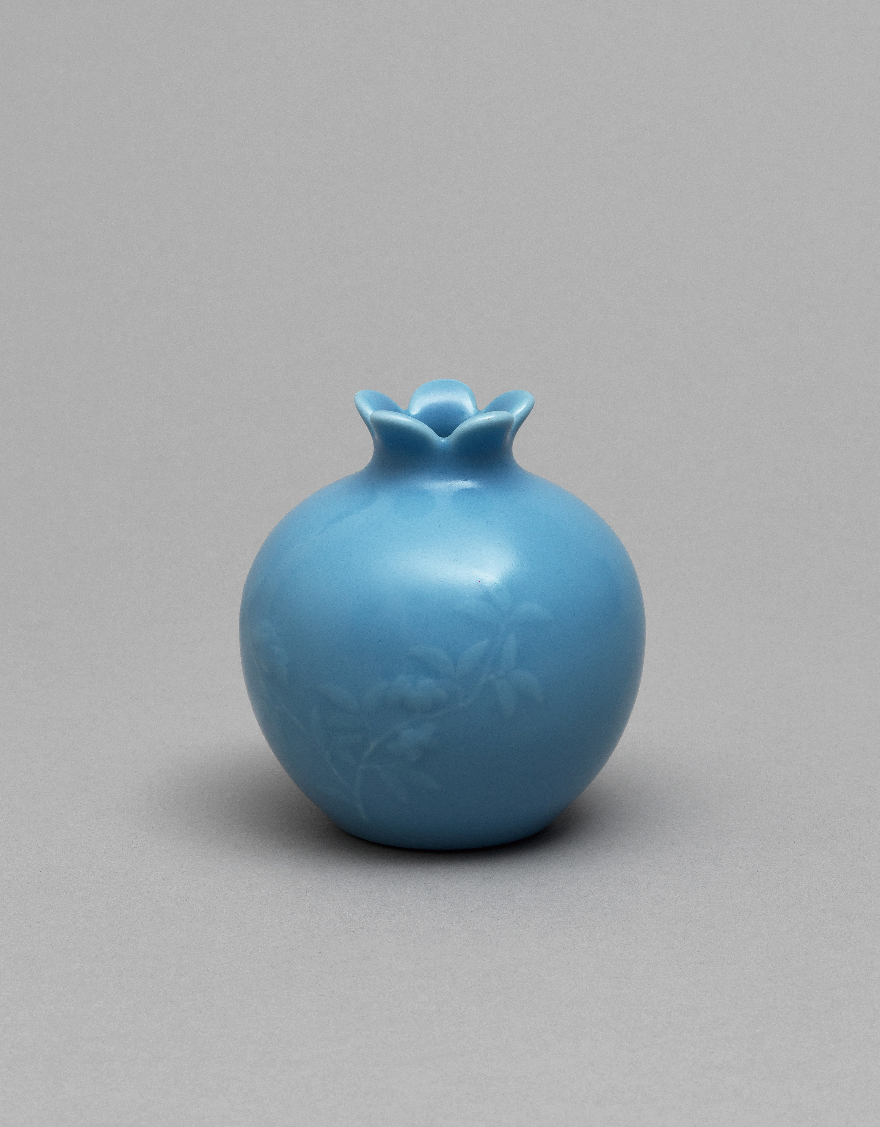 Lot 1 - A small pale-blue-glazed pomegranate vase, Qing Dynasty, Haoran Tang hallmark, Daoguang Period