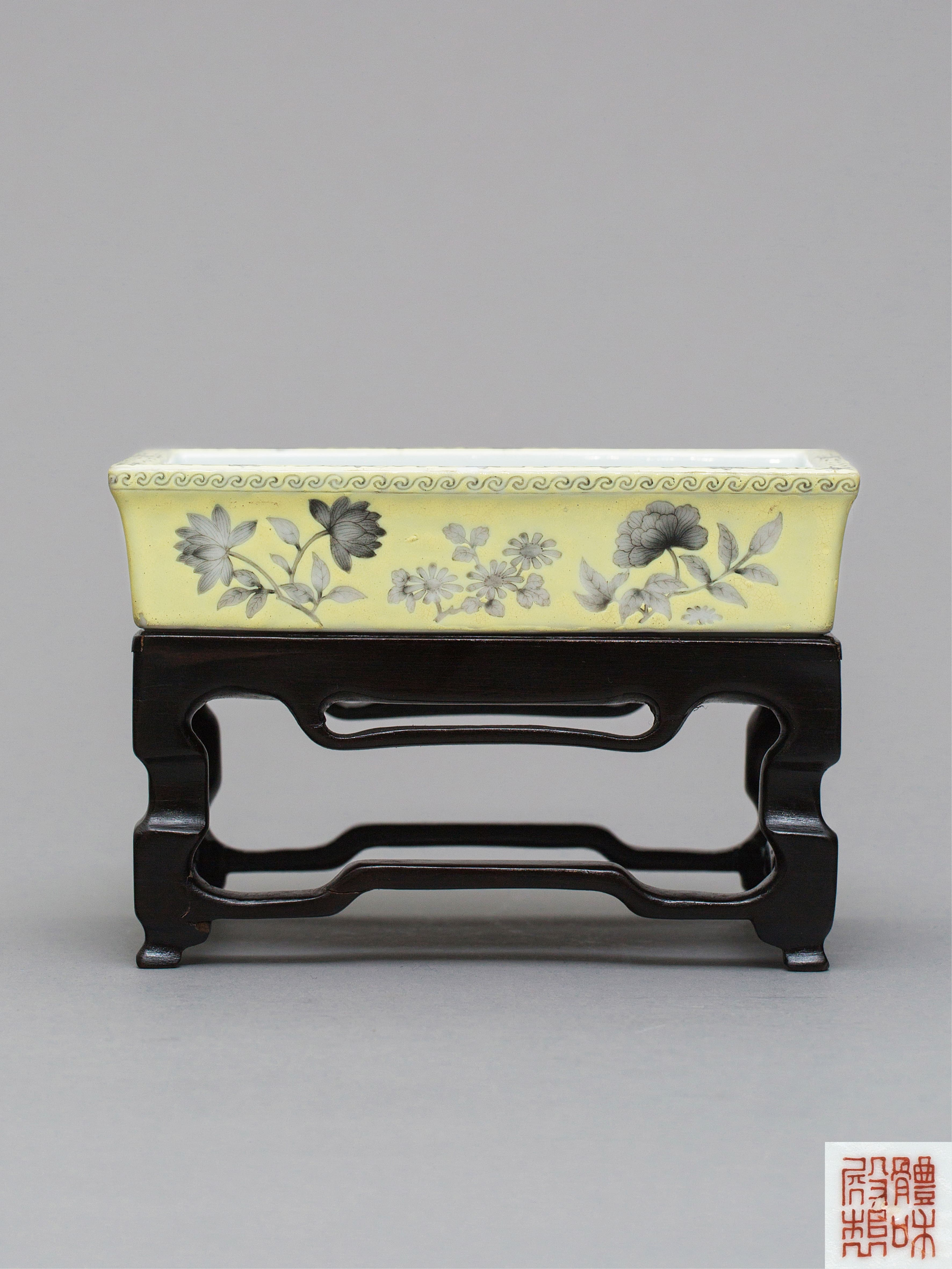Lot 35 - A grisaille and yellow-ground narcissus bowl,iron-red 'Tihedianzhi' mark, Guangxu period