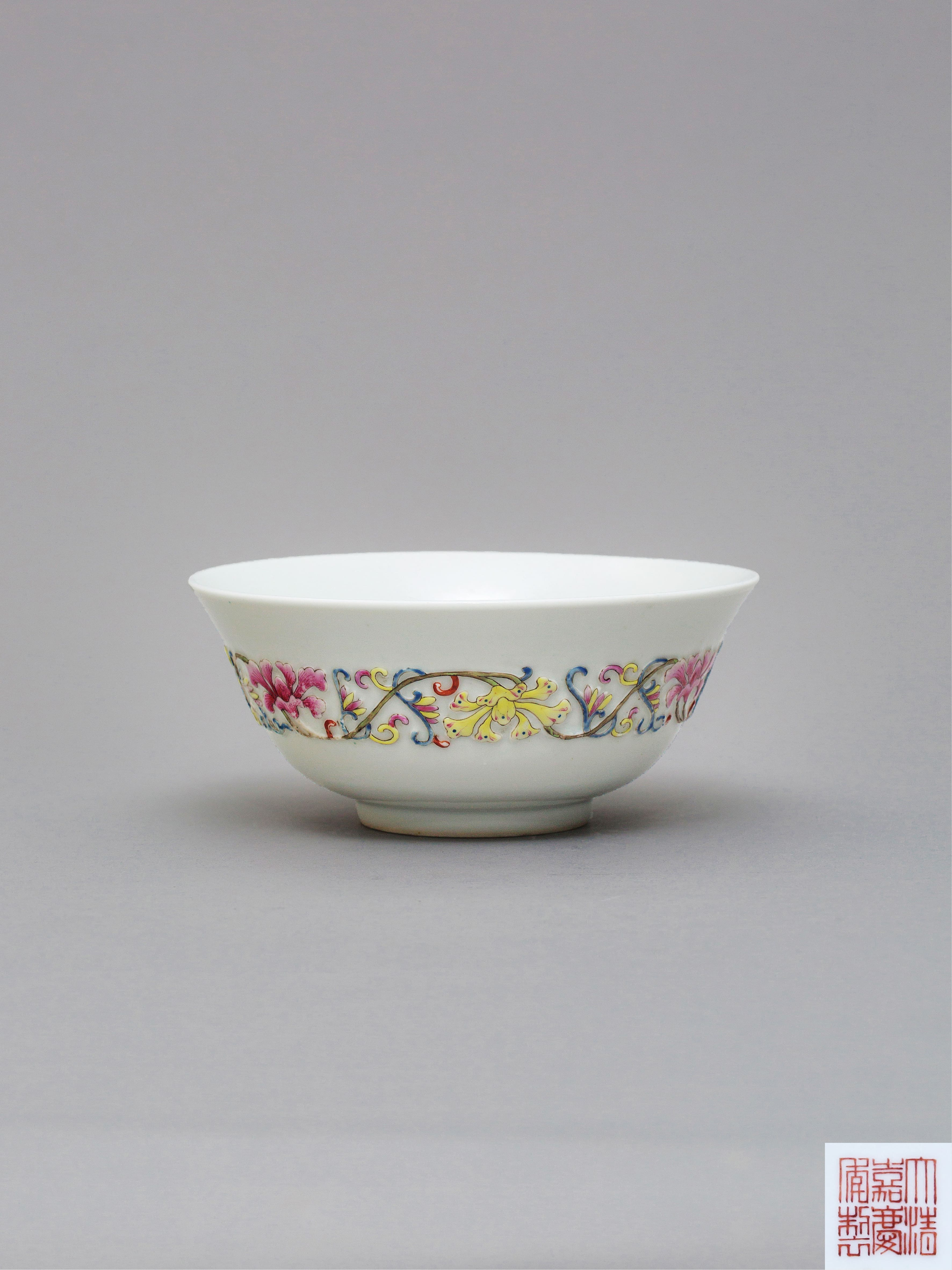 Lot 41 - A 'famille-rose' relief-moulded bowl Jiaqing six-character iron red seal mark and of the period