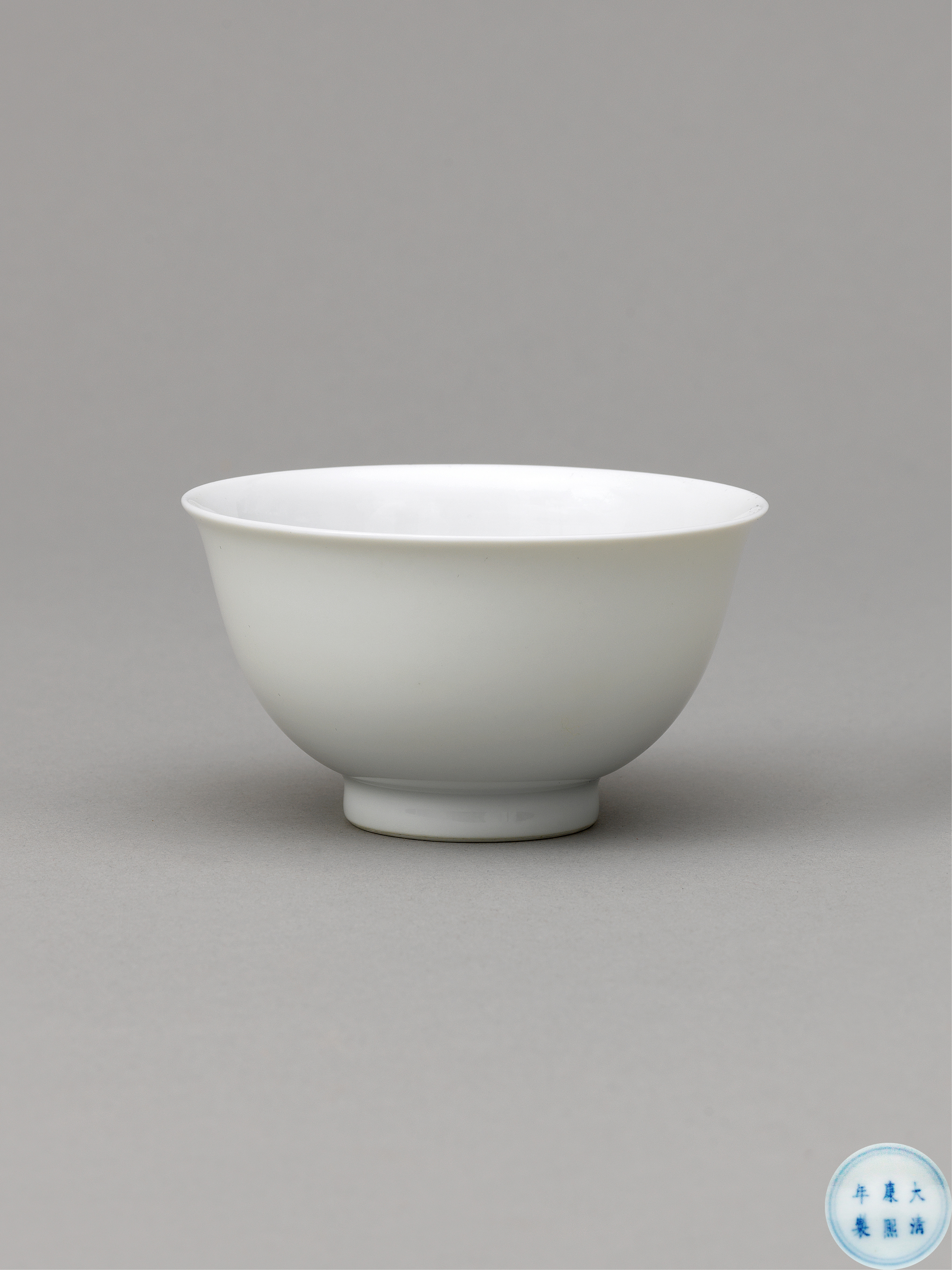 Lot 25 - A white glazed cup, Qing Dynasty, Kangxi mark and period