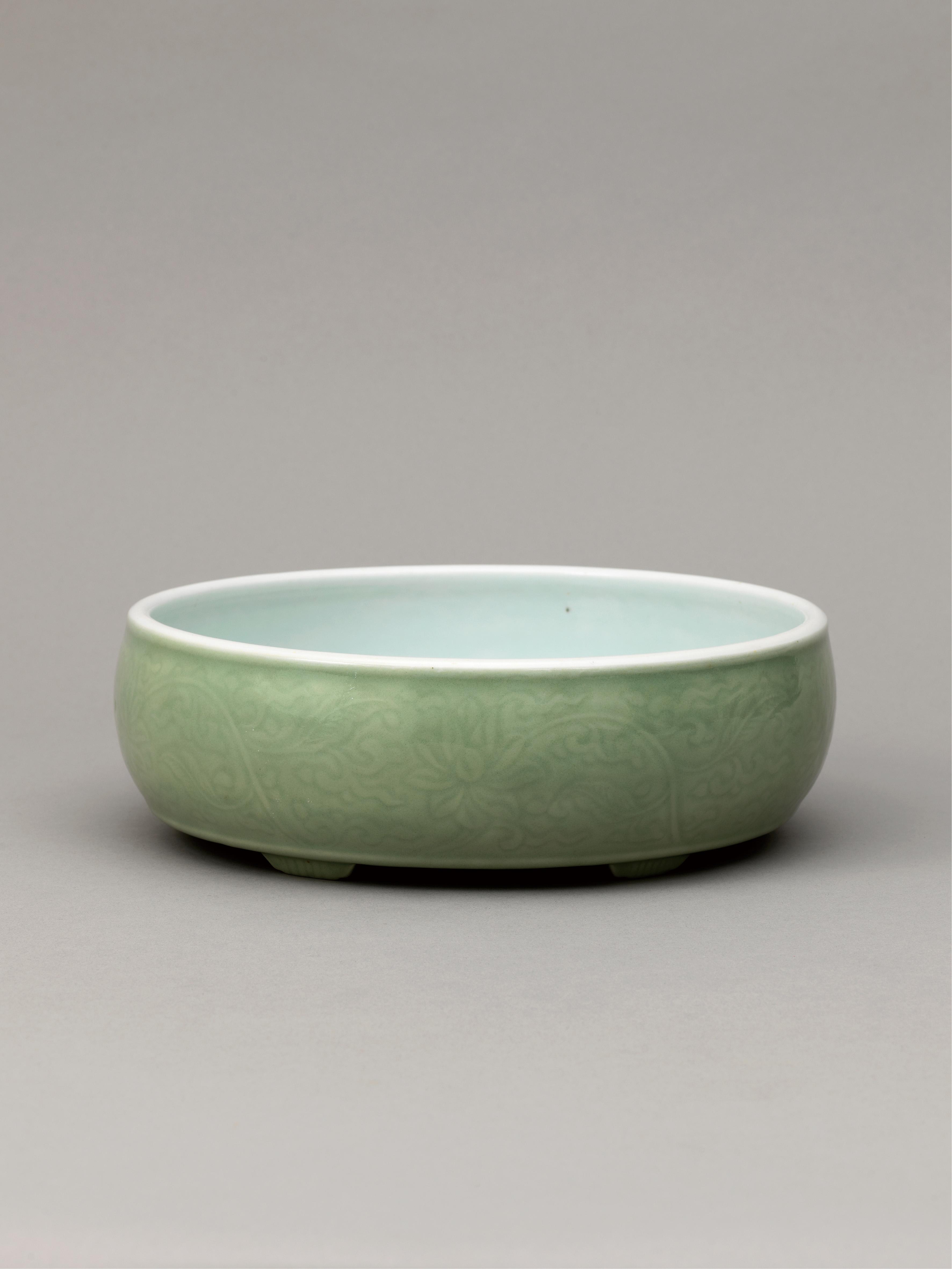Lot 6 - A pale green glazed brush washer, Qing Dynasty, Qianlong Period (1736-1795)
