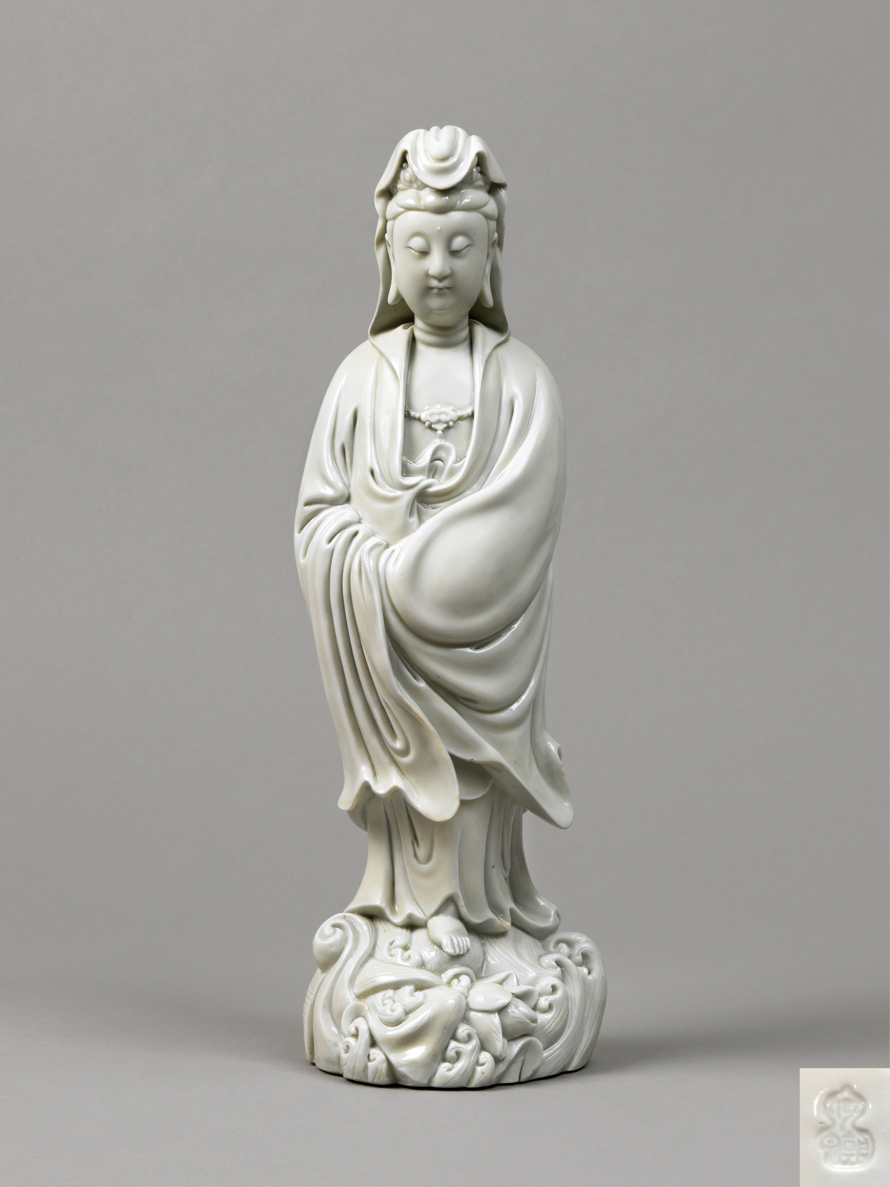 Lot 27 - A rare Dehua figure of Guanyin,16th-early 17th Century, He Chaozong impressed seal mark