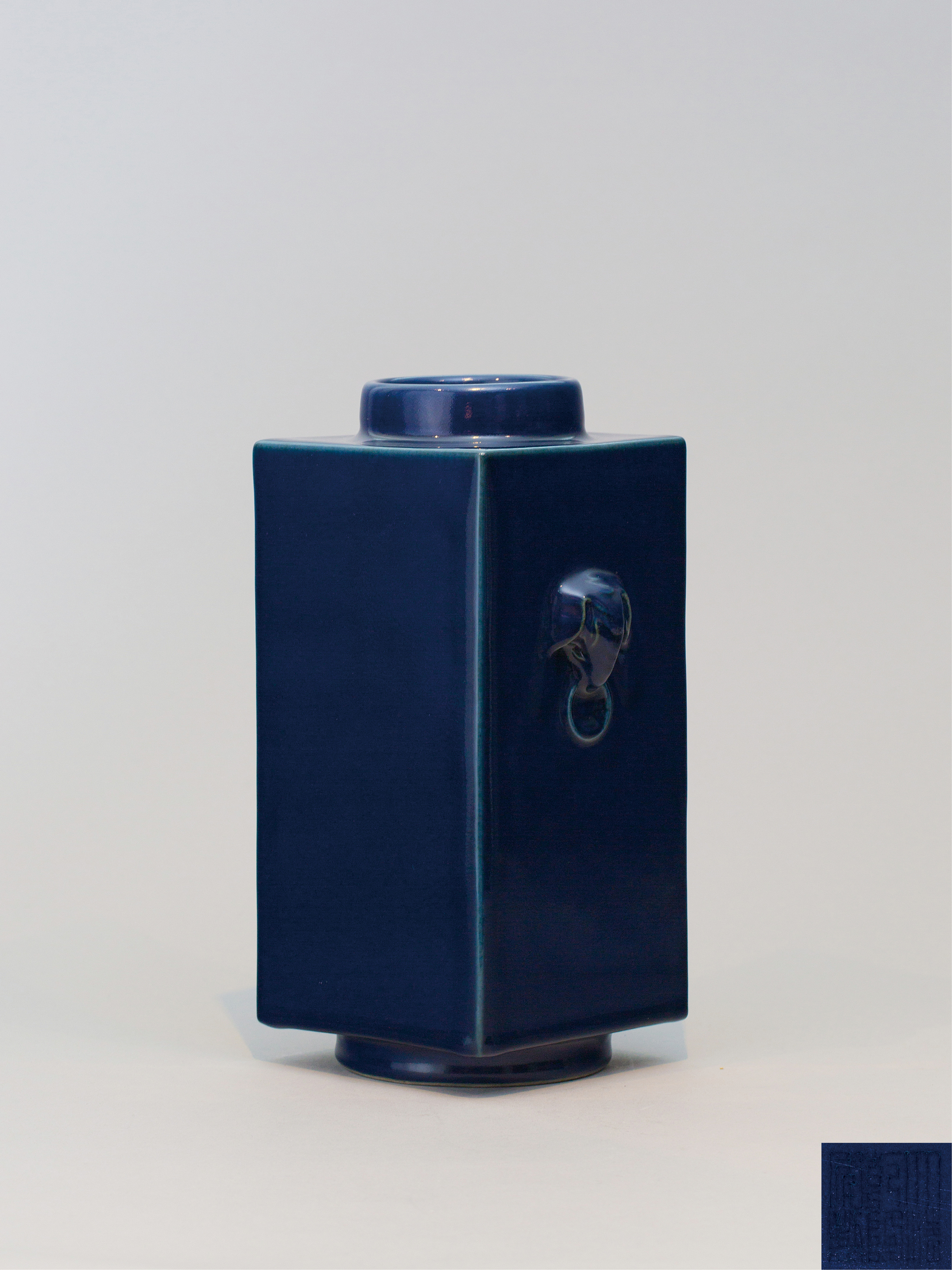 Lot 9 - A blue-glazed square-form vase, Qianlong seal mark and of the period