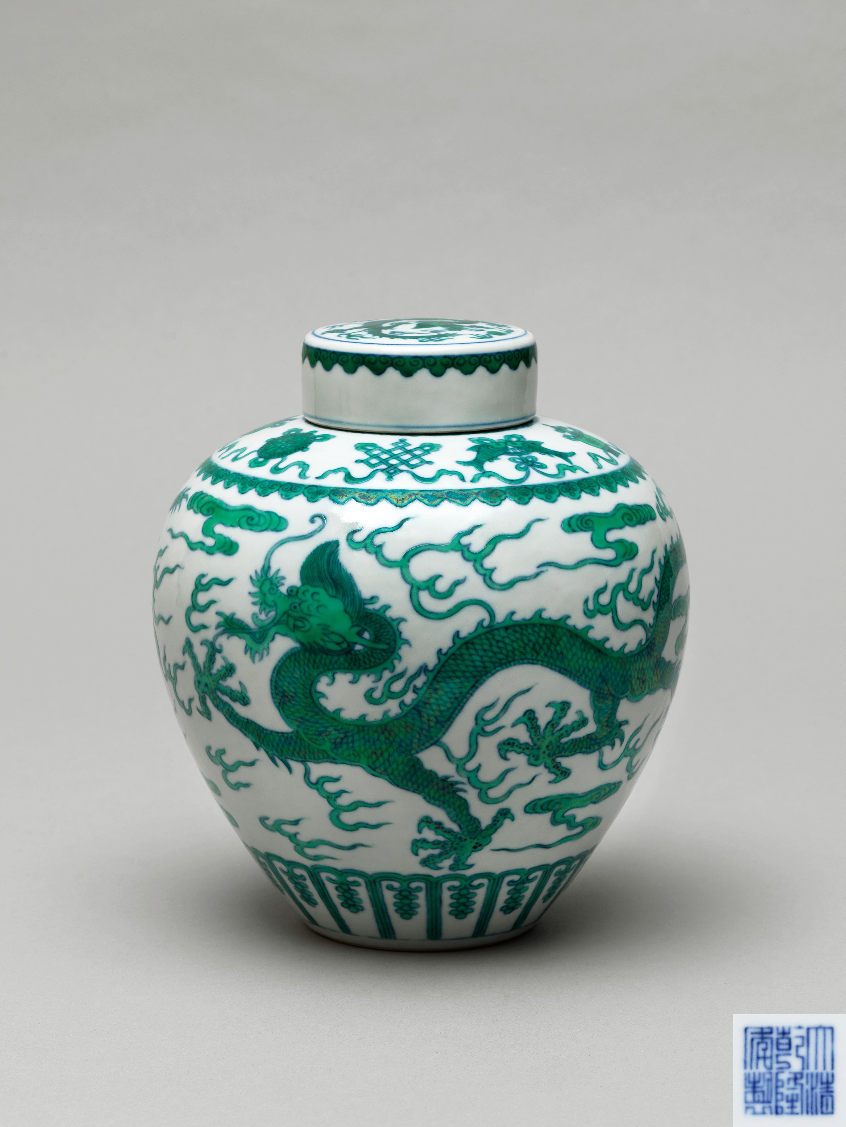 Lot 33 - A green-enamelled dragon jar and cover, Qianlong six-character seal mark and of the period