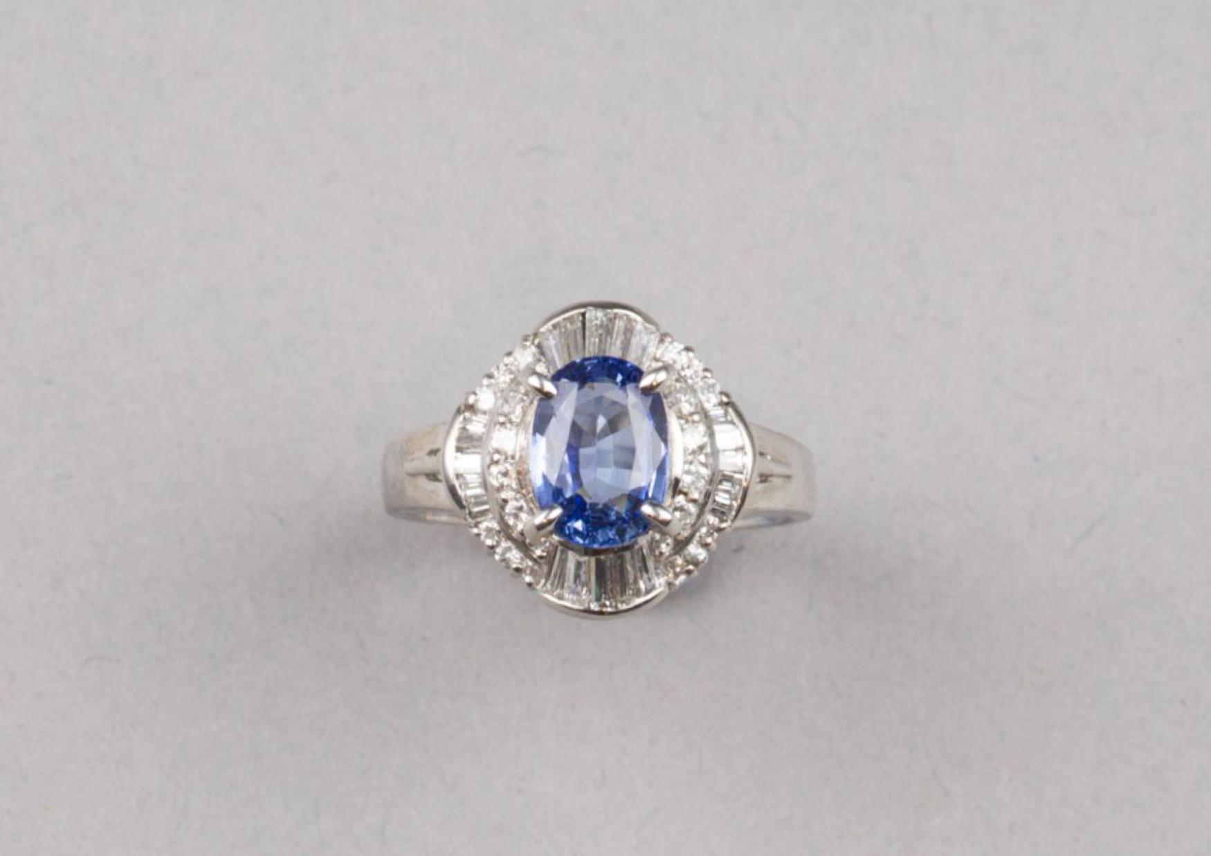 Lot 57 - Platinum Sapphire Diamond Ring