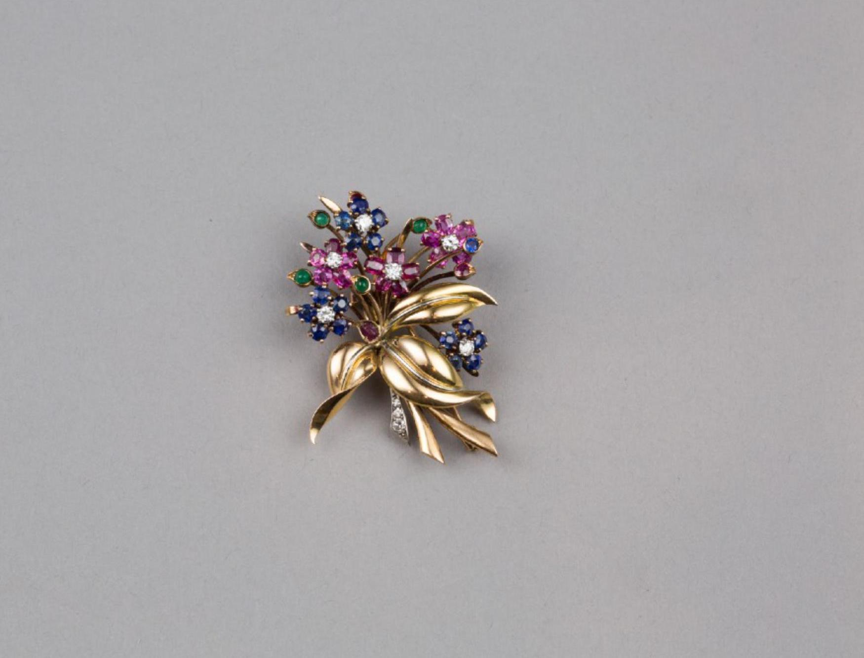 Lot 43 - A 18K Gold Emerald Sapphire Ruby and Diamond Brooch