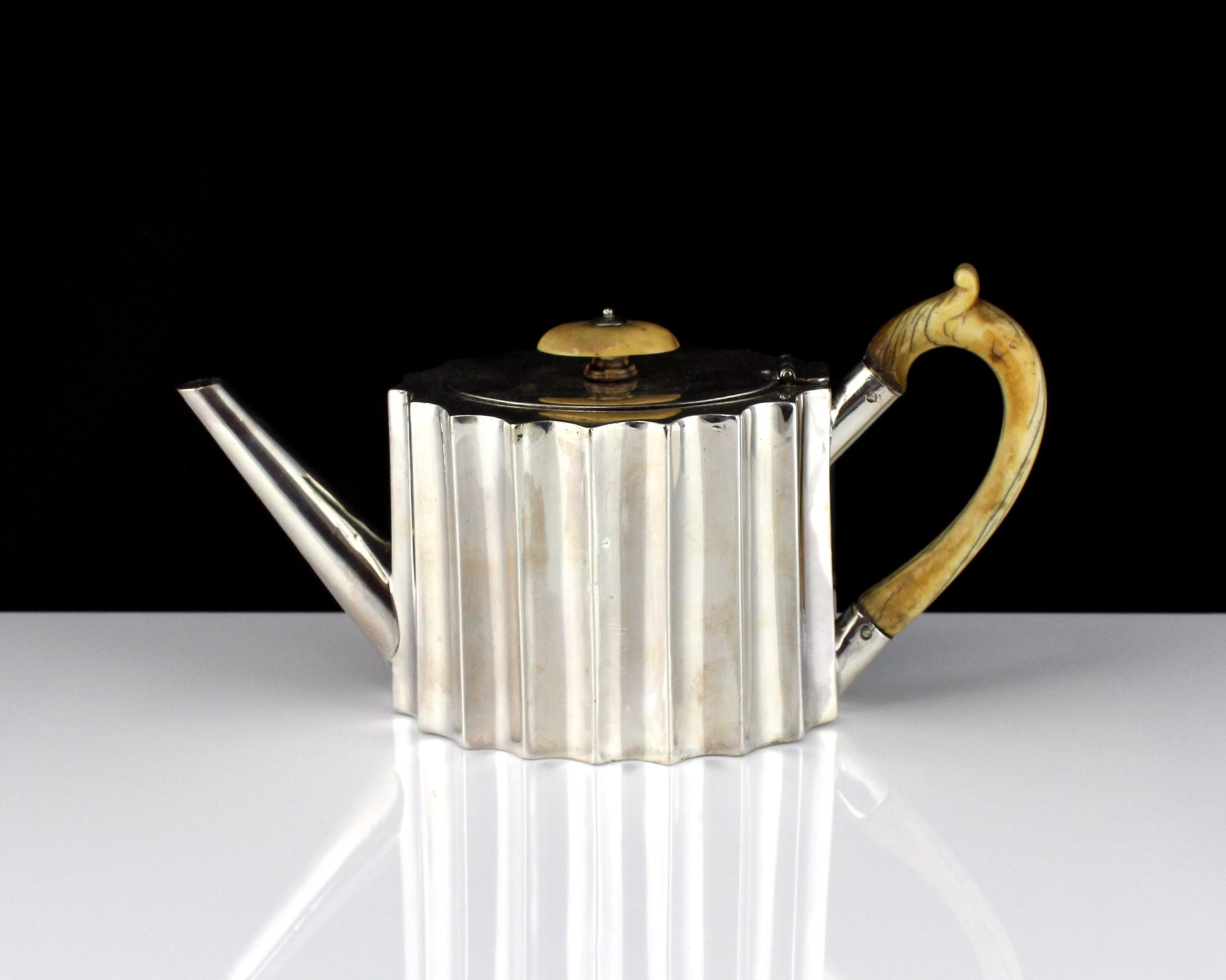 An antique Victorian Sterling Silver bachelor's teapot by William Comyns, London 1867 of navette