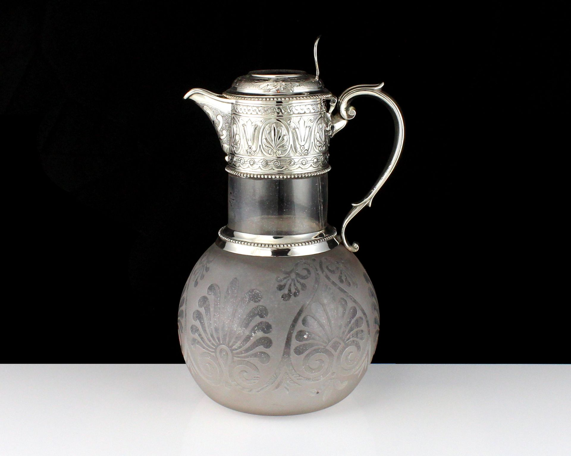 An antique Victorian Sterling Silver mounted claret jug by William & George Sissons, Sheffield
