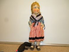 A 1930s vintage doll originally from the Savoie region of France. Composite face and hands, soft
