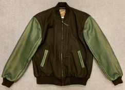 An original unworn 'varsity' style jacket (black with green leather arms & detailing) produced