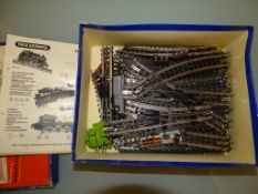 A box containing a large quantity of TRIX EXPRESS 3 rail track including points and crossovers etc -