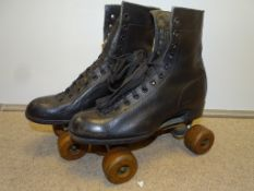A pair of adult sized vintage leather roller skates from 1950s/60s, size 6 - some rust to metal
