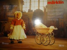 A MÄRKLIN 'KINDERTRAUM' 1611 limited edition tinplate reproduction DOLL'S PRAM AND HEIDI OTT DOLL