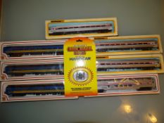 A group of American Outline coaches by BACHMANN in Amtrak, and VIA liveries together with a
