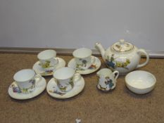 "A 1930s children's play teaset - some cracks and minor damage but complete as lotted, marked ""CB"""