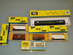 A German outline small shunting locomotive together with a coach and selection of boxed wagons and
