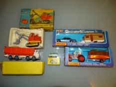A mixed group of vintage diecast models to include a Dinky 925 Leyland Dump Truck (F - part