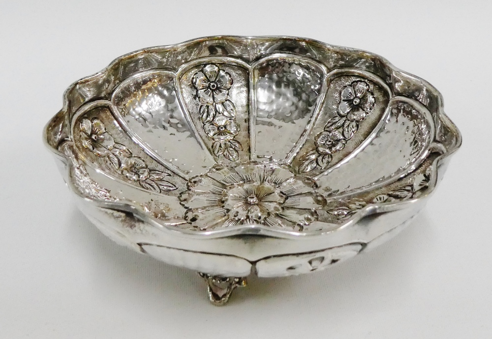 Lot 1 - Greek silver bowl of circular scalloped form with repousee floral panels, raised on three out