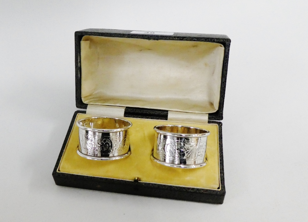 Lot 48 - A cased set of two Birmingham silver napkin rings (2)